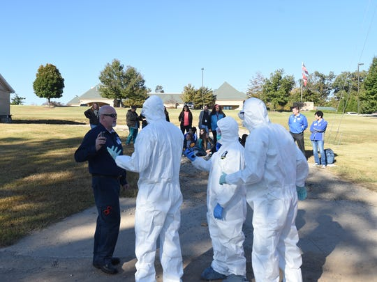 Baxter Regional Medical Center holds a full-scale community drill Wednesday morning in partnership with local agencies. Mountain Home High School students portrayed contaminated and injured patients during the drill.
