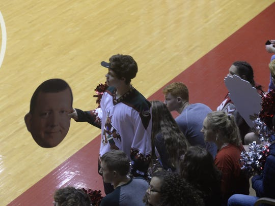 Isiaiah Cox of the Bleacher Creatures holds a cutout