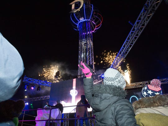Spectators watch the early family New Year's Eve ball drop at Beacon Park.