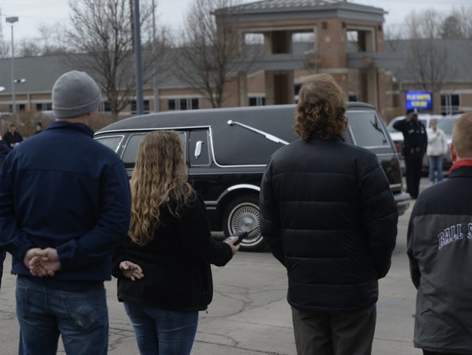 The funeral procession of Patrolman Dave Skaggs stopped