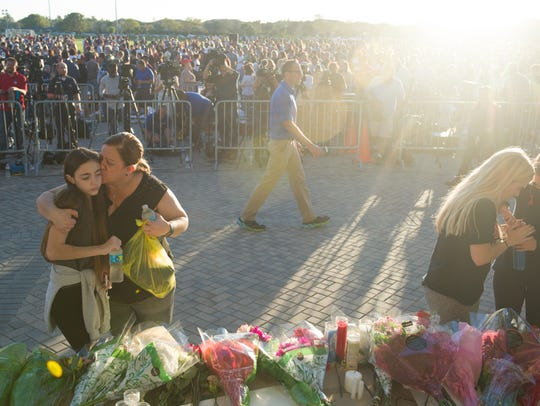 Thousands gathered at the candlelight vigil Thursday,