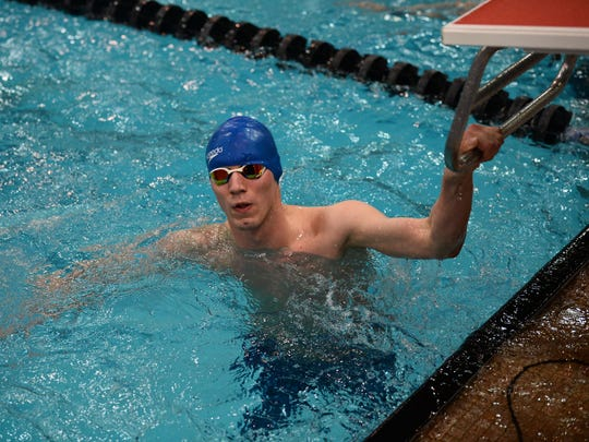 Ontario junior David Whittaker checks the scoreboard after earning All-Ohio honors in the 50 freestyle.