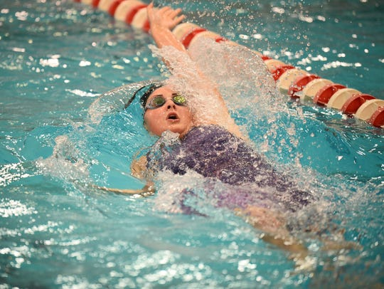 Lexington senior Kelsi Brown en route to a medal in the 100 backstroke at the state swim meet.