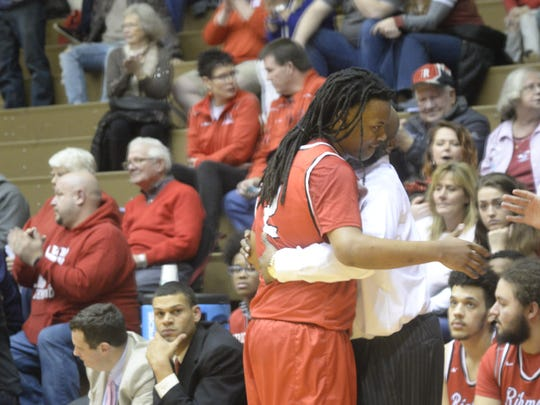 Richmond's Kei'Shaun Clemons is welcomed to the bench