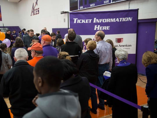 Fans had a chance to sign up for season tickets after being introduced Friday to new men's basketball coach Walter McCarty at Meeks Family Fieldhouse.