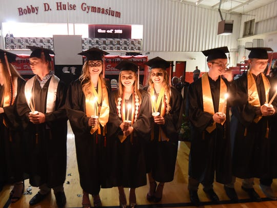 The Norfork High School Class of 2018 light candles