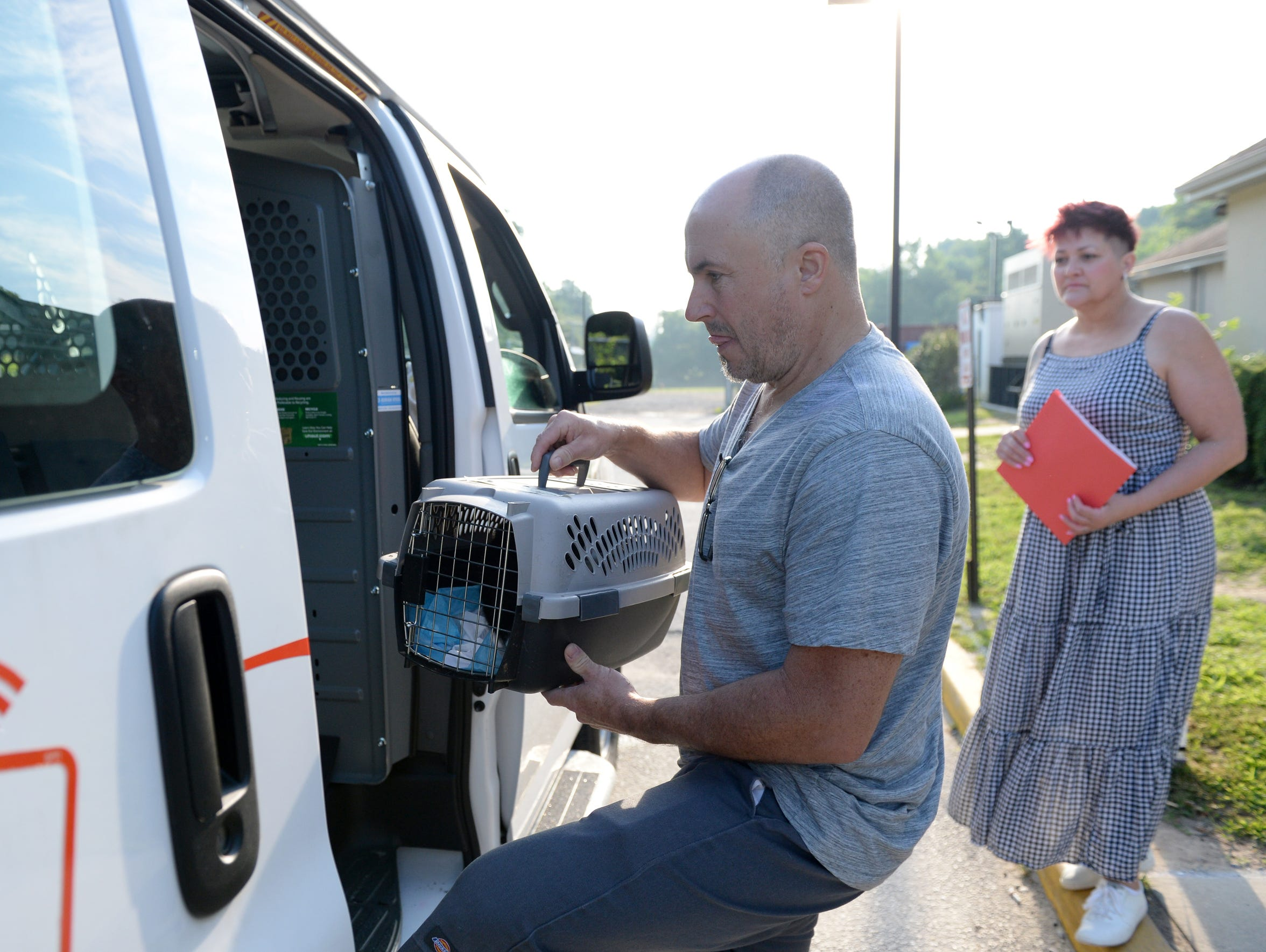 Jeff Matteis, volunteer, places a crate of kittens
