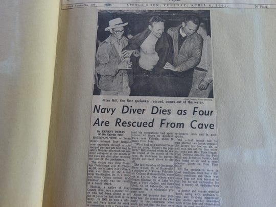 A faded newspaper article from 1965 details the rescue