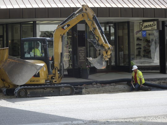 A crew works along South Eighth Street on Friday morning.