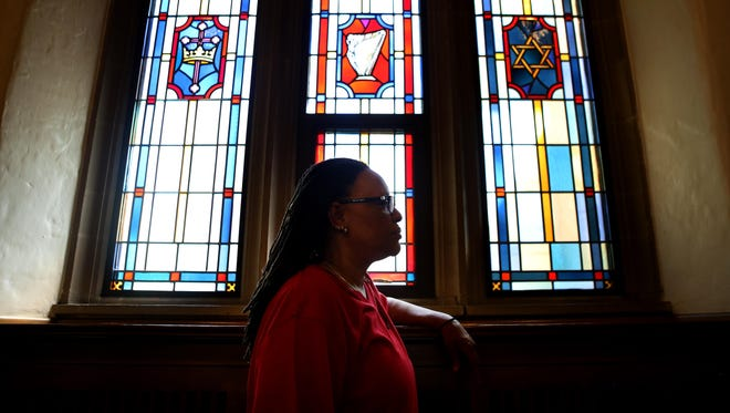 Pastor Terry Hocker, 56, poses for a portrait inside All Saints Episcopal Church Wednesday, May 13, 2015 where his Bound by Truth and Love Ministries congregation gathers every Sunday.