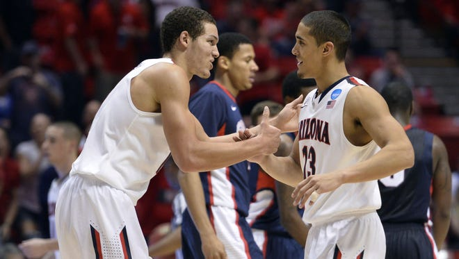 Arizona Wildcats forward Aaron Gordon (left) celebrates with guard Nick Johnson (right) in the second half of a men's college basketball game during the third round of the 2014 NCAA Tournament against the Gonzaga Bulldogs at Viejas Arena on March 23, 2014.