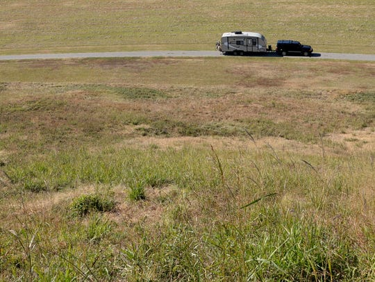 A car drives the 2.5 mile path through Poverty Point