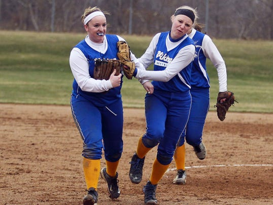 Northern Lebanon's Erica Dulac, left, and Jess Kreiser celebrate the Vikings' 7-5 softball win over Elco on Wednesday in Fredericksburg.