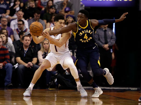 Pacers guard Victor Oladipo steals the ball on Suns guard Devin Booker in the first half of Sunday's Suns loss.