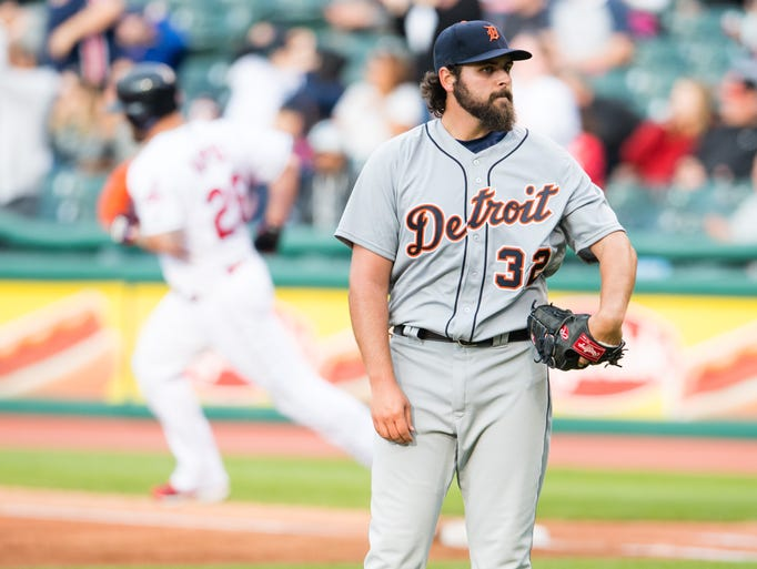 Detroit Tigers' starting pitcher Michael Fulmer reacts