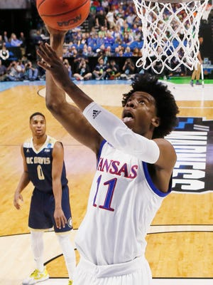 Kansas guard Josh Jackson (11) shoots in front of UC Davis guard Brynton Lemar (0) in the first half of a first-round game in the men's NCAA college basketball tournament in Tulsa, Okla., Friday, March 17, 2017. (AP Photo/Sue Ogrocki)