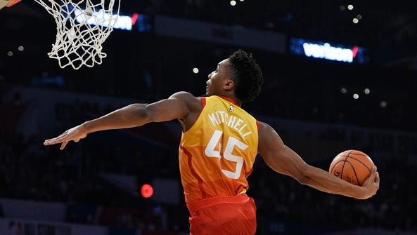 Utah Jazz's Donovan Mitchell goes up for a dunk during