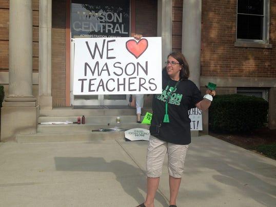 1404831470000-mason-protest-1