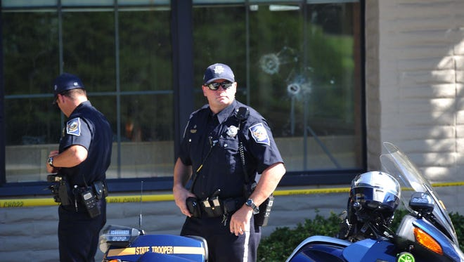 Two officers process the scene at the south Carson City IHOP follwoing Tuesday's shooting that left three people dead. Photo by Tim Dunn/RGJ