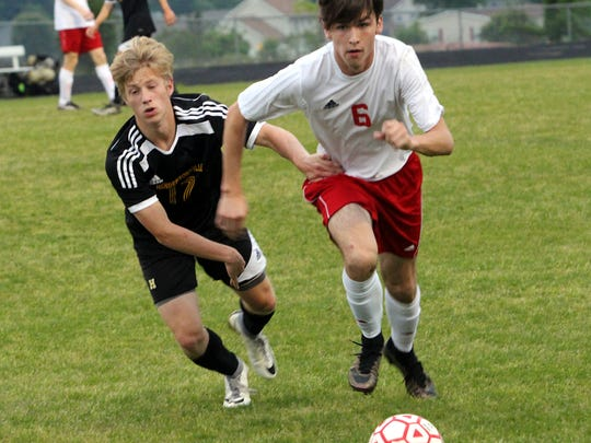 Rossview's Jared Stanford (6) and Hendersonville senior Darius Campbell battle for possession during the first half of a Region 5-AAA Tournament semifinal match on Tuesday evening.