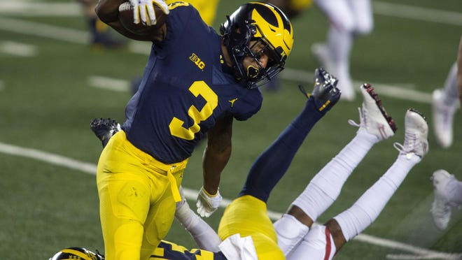 Michigan wide receiver A.J. Henning (3) rushes around a block for him from tight end Erick All (83) in the first quarter of an NCAA college football game against Wisconsin. Michigan is scheduled to visit Rutgers Saturday night.