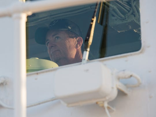 Eddie Somers, captain of the J. Millard Tawes, watches as he steers his boat toward Smith Island.