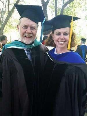 Jerry Mitchell (left) is shown in a photo with Stephanie Clanton Rolph. Mitchell received an honorary degree from Millsaps College on Saturday, May 7, 2016.