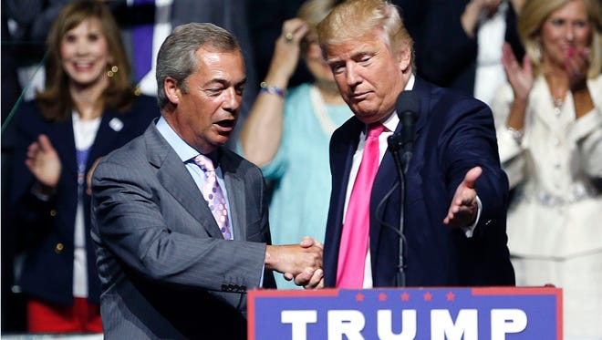 In this Wednesday, Aug. 24, 2016, file photo, then-Republican presidential candidate Donald Trump, right, welcomes pro-Brexit British politician Nigel Farage, to speak at a campaign rally in Jackson, Miss.