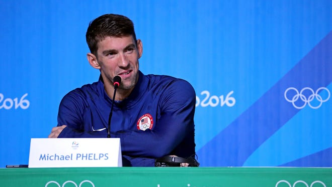 Swimmer Michael Phelps speaks during a press conference at the MPC Samba Room prior to the 2016 Rio Olympic Games on Aug. 3.