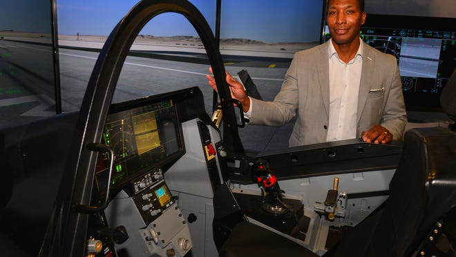 On Thursday in Malabar, Harris Corp. celebrated the delivery of its millionth part for the F-35 jet program led by Lockheed Martin. Bryant Henson, Vice President/General Manager, Avionics Business Unit, Electronics Systems for Harris, stands by a Lockheed Martin F-35 simulator that employees were able to try out.