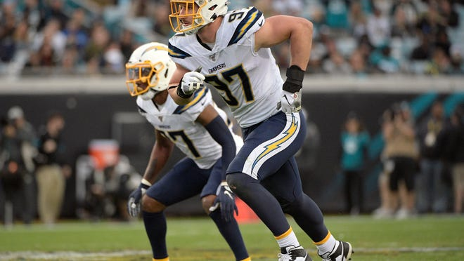 FILE - In this Sunday, Dec. 8, 2019 file photo, Los Angeles Chargers defensive end Joey Bosa (97) follows a play during the first half of an NFL football game against the Jacksonville Jaguars in Jacksonville, Fla. Defensive end Joey Bosa has agreed to a six-year, $135 million contract extension with the Los Angeles Chargers, according to multiple people familiar with the decision. The people spoke to The Associated Press on condition of anonymity Tuesday, July 28, 2020 because the contract has not been finalized.