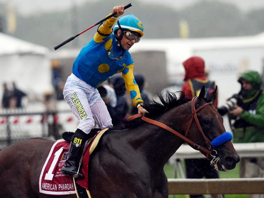Victor Espinoza, aboard American Pharoah, celebrates.. American Pharoah will the 14th horse to go for the Triple Crown since 1978.