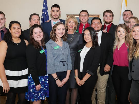 York College of Pennsylvania students met recently with U.S. Secretary of Education Betsy DeVos, center, as part of the College's #SpartaNation tour. The visit to Washington, D.C., was organized by the Department of Alumni Relations as part of the East Coast tour dubbed #SpartaNation, which included stops in New York City, Philadelphia, New Jersey, and Baltimore. Students were exposed to the historical, cultural, industrial, and civic attractions of each city, while engaging with York College alumni and friends along the way. submitted photo