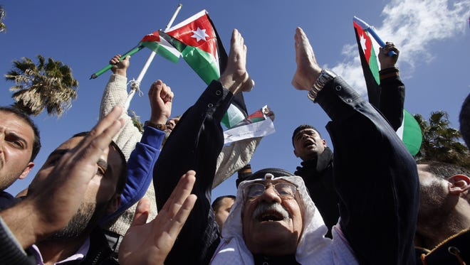 Jordanians show their support for the government against terrorism in Amman, Jordan, on Feb. 4.