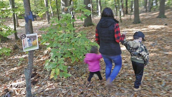 Morgan Young participates in the StoryWalk at Hartstuff Park in Rockland with her children, Isla 2, and Grayson, 5 on Monday Oct. 19, 2020.