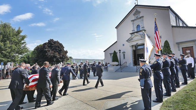 "Pallbearers carry Bill Varroso´s casket to service at Saint Francis of Assisi Church.  Funeral service for Bill Varroso 94 of Braintree, a WWII veteran who was also a retired Braintree police officer known as ""Officer BillÓ by many on Thursday July 30, 2020 Greg Derr/The Patriot Ledger"