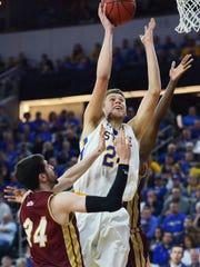 SDSU's Mike Daum (24) takes a shot past Denver's Marcus