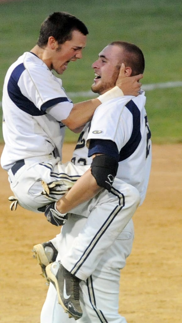 Grant Petty, left, and Alex Ledford celebrate after Roberson won the 4-A Western Regional baseball championship in 2011.