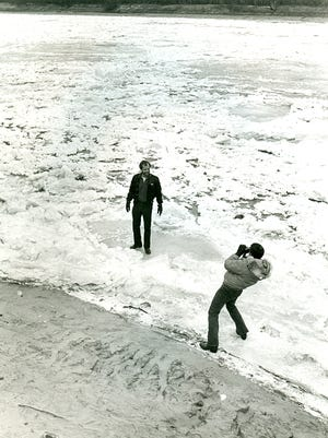People walking on the frozen Red River, December 1983.