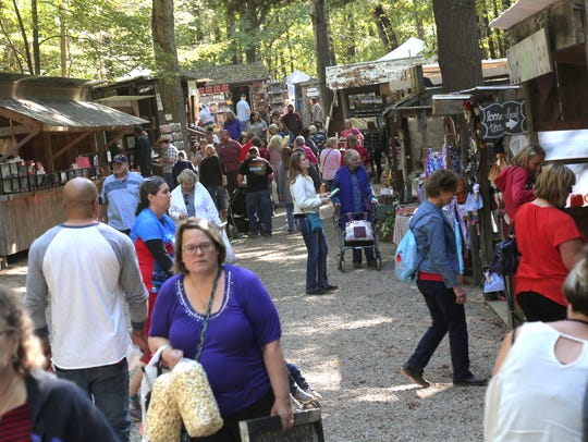 Crowds line the midway of the Prairie Peddler Festival