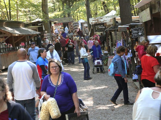 Crowds line the midway of the Prairie Peddler Festival near Butler on Saturday. There were over 180 artisan booths selling various crafts.