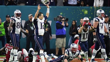 New England Patriots quarterback Tom Brady (12) reacts to the game winning touchdown against the Atlanta Falcons during over time during Super Bowl LI at NRG Stadium.