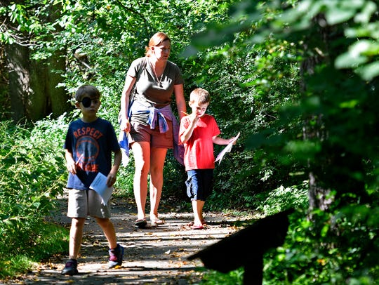 Amy Kauffman, center, of York, walks with her sons