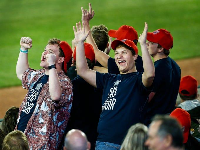 Several Memphis Redbirds fans dance to the music between