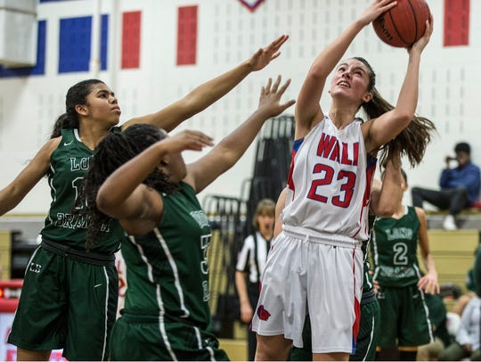 Wall's Tara Casuccio shoots. Long Branch vs Wall basketball.