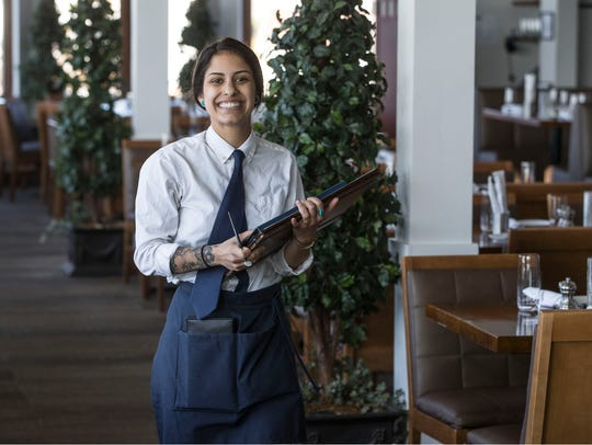 Waitress Nicole Ocello serves lunch patrons of Rum