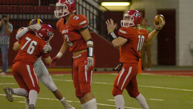 Gregory quarterback Andy McCance, right, prepares to pass while Cade Fortuna (76) and Jayd VanDerWerff (3) block.
