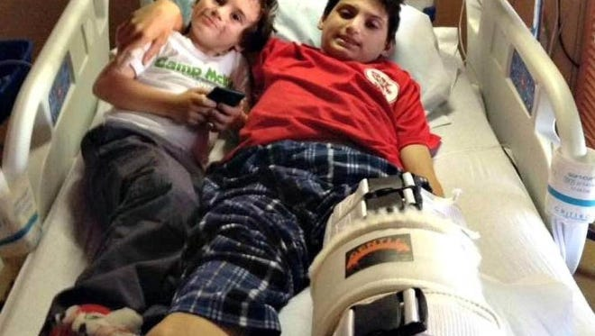 Jaxon Ronsonet, 15, of Biloxi lost his left leg in a pit bull attack, but managed to save his 5-year-old brother, Bentley. Jaxon and Bentley's mother says the boys' father took $8,000 from a GoFundMe account meant to help with medical expenses.
