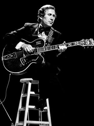 Chet Atkins entertains the crowd during the nationally televised CMA Awards show at the Grand Ole Opry House on Oct. 13, 1975.