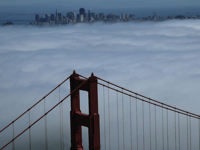 The north tower of the Golden Gate Bridge is visible through the fog on Sept. 8 in San Francisco.